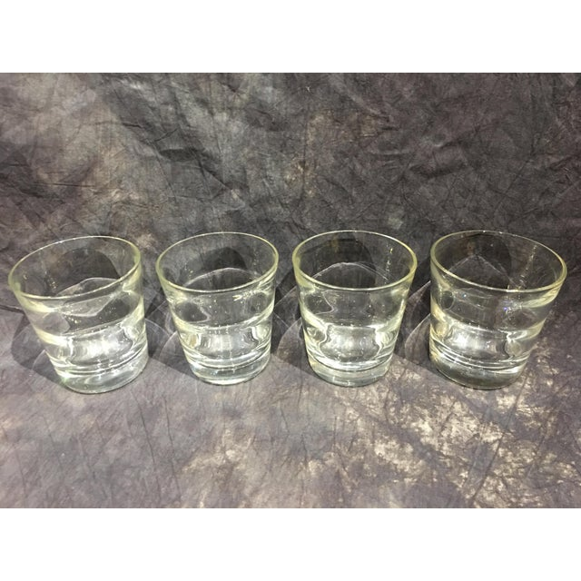 An elegant group of 4 signed Tiffany & Co. lowball glasses. Standard barware gets a modern Tiffany update in this crisp...