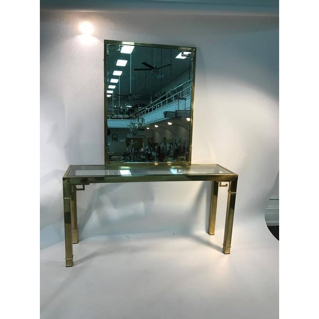A stunning solid brass Italian mirror and console table with Greek key design. Magnificent stylish look, circa 1970. Good...