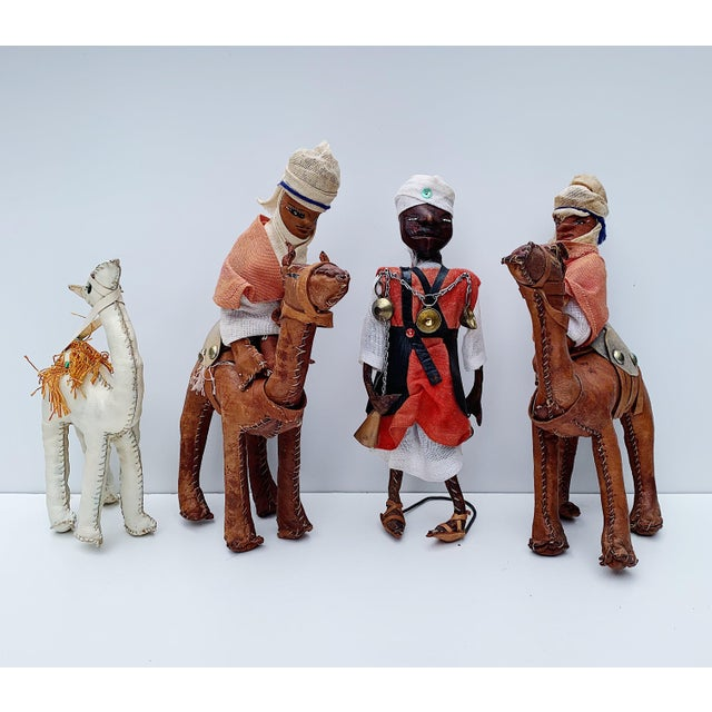 "Set of 4 vintage middle eastern handmade leather figurines with stuffed straw filling. 2 camels with riders: 6.75""W x..."