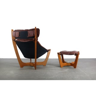 Highback Luna Chair With Ottoman in Milk Chocolate Leather by Img Norway Designed by Odd Knutsen Preview