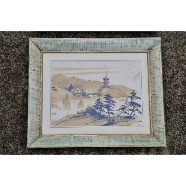 A pair of vintage Mid-Century Chinoiserie Aisian inspired works on paper framed under glass in vintage distressed frames....