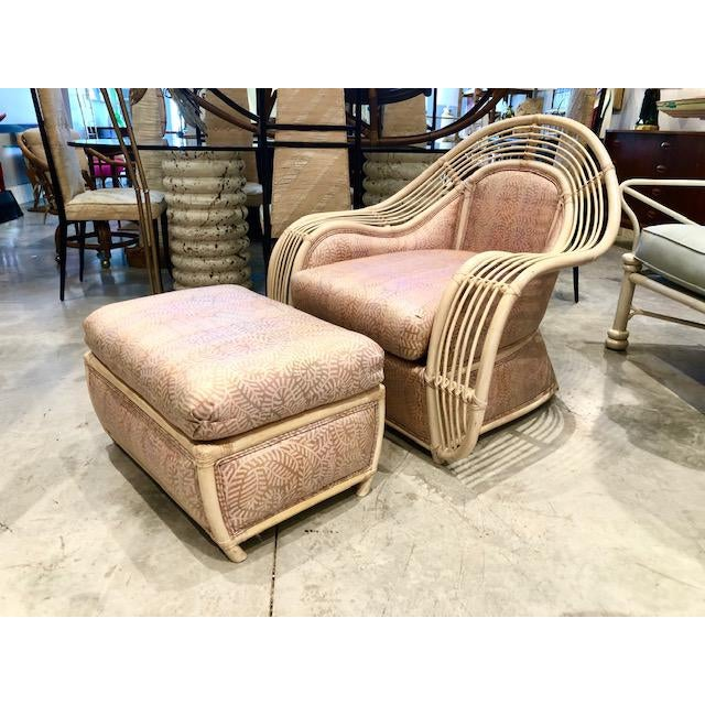 This is a fantastic large rattan and reed chair and ottoman in the Hollywood Regency style with rose pattern fabric for...