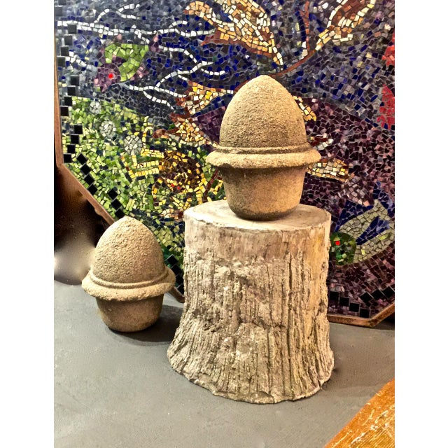 This is a very decorative pair of antique 19th century cement garden finials in the form of acorns. The degraded cement...