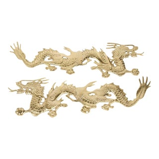 Asian Cast Brass Dragons Chasing a Ball, Wall Mount - A Pair For Sale