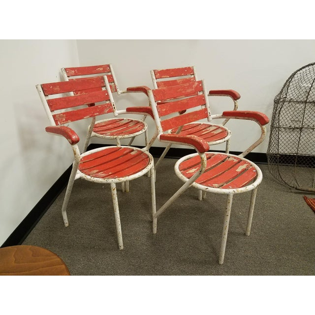 A cute set of red and white garden arm chairs . Great around a bistro table or wine tasting table too. *Please remember:...