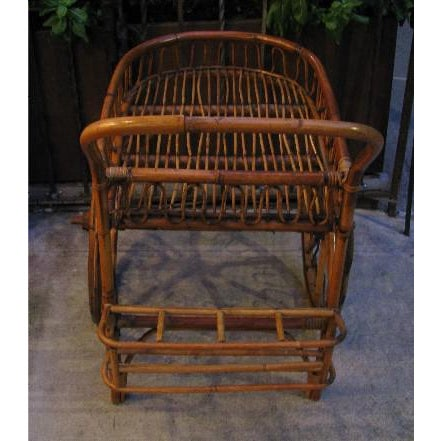 """This cart is typically known as a """"French Riviera"""" Rattan Bar Cart from the 1950s. Ours however, was clearly made in Italy..."""