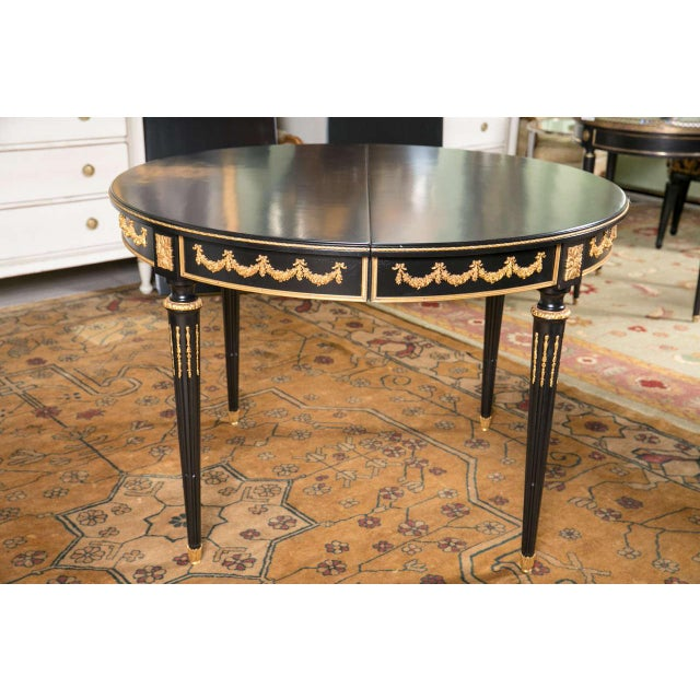 "Having two 19.75"" leaves, this is simply one of the finest French Louis XVI-style ebonized dining tables by Maison Jansen...."
