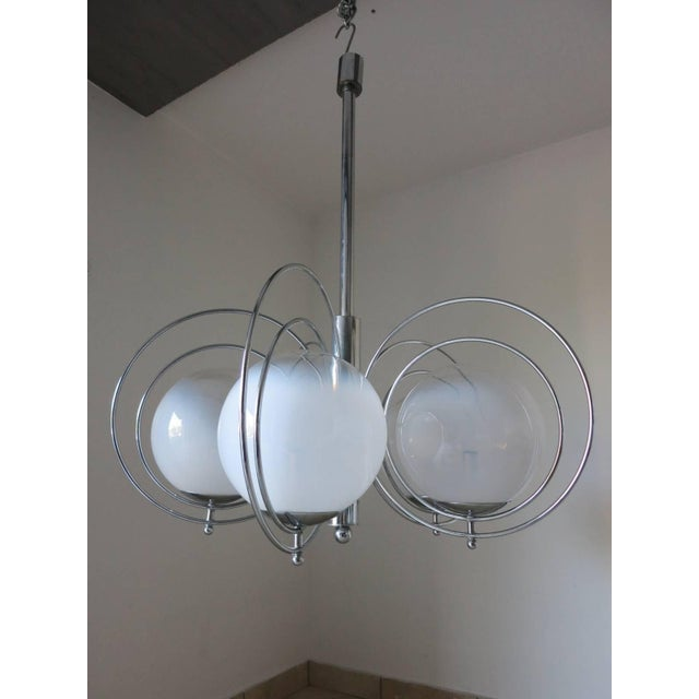 Vintage Italian chandelier or pendant with five glossy white Murano glass globes and chrome chandelier, by Goffredo...