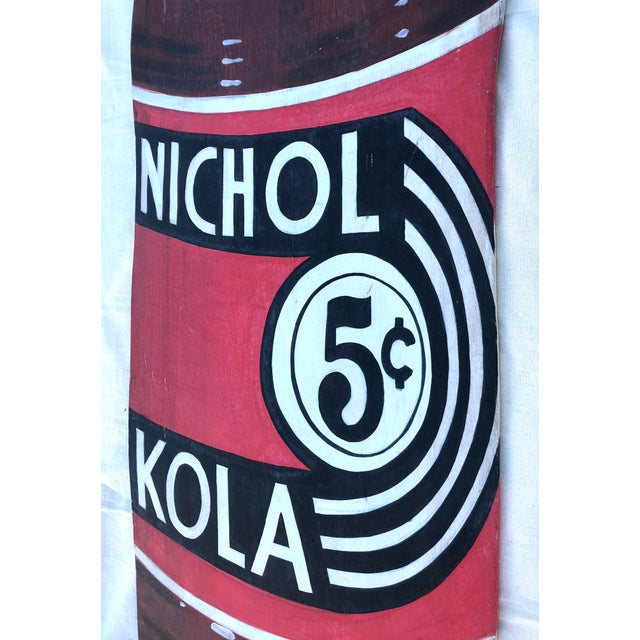 Up for auction is an antique, advertising sign for Nichol Kola, a small soft drink company. This sign is easily dated, as...