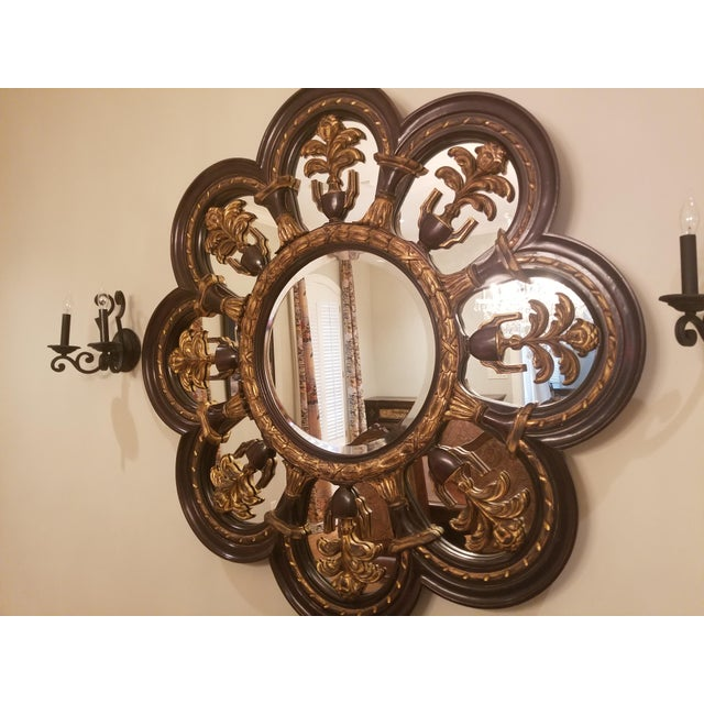 Large black wood New Orleans Style mirror with gold accent acanthus leaf detail.