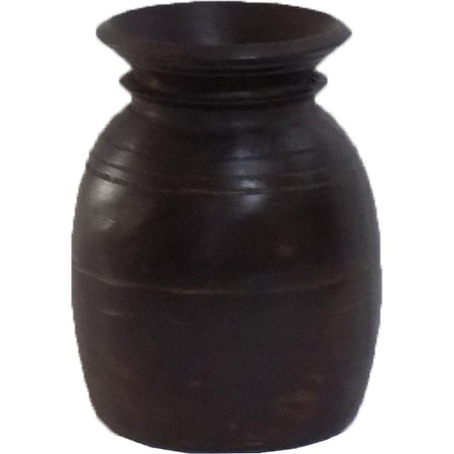 This pot with neck was made in India.