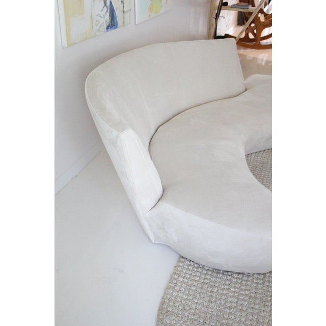 A sculptural modern sofa designed by Vladimir Kagan and inspired by the curves of the Guggenheim Museum in Bilbao Spain,...