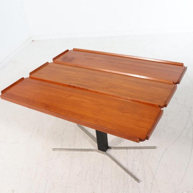 I have a very cool mid-century Danish modern teak drop leaf table. This table is adjustable up and down and also is a drop...