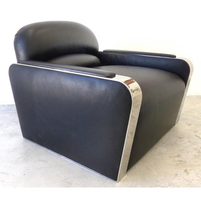 Offered for sale is a substantial and comfortable pair of Streamline Modern Art Deco style stainless steel and leather...