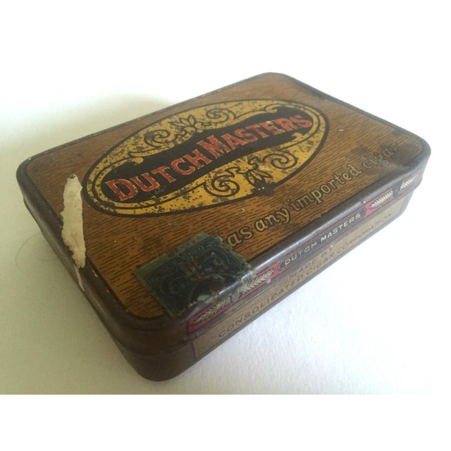 This vintage early 1900's Dutch Masters metal lithograph cigar tin box with lid is a very special and unique piece to add...