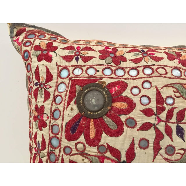19th century, Rajasthani colorful embroidery textile made into a decorative throw pillow. Handcrafted with floral pattern...