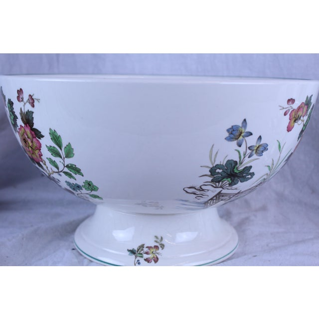 "White ceramic punch bowl with Asian floral details. ""Eastern Flowers"" pattern, by Wedgwood."