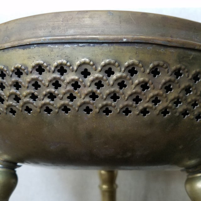 Authentic vintage Middle Eastern foot warmer/fire stool brazier in solid brass. The brass has and etched floral pattern on...
