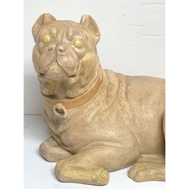 Antique English terracotta recumbent pug dog, realistically modeled and subtly polychromed. Rare form.