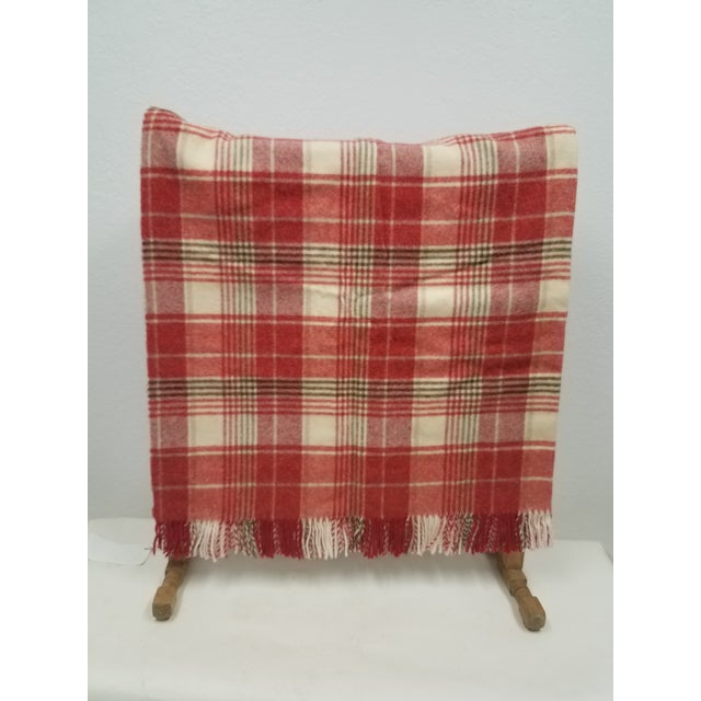 Wool Throw Reds Black White Plaid - Made in England A versatile throw in a plaid design. The colors are reds, white and...