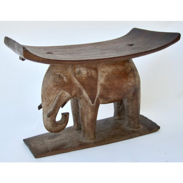 Lovely Ashanti or Asanti tribal stool, early to mid-20th century, hand-carved base in the form of an elephant. Nice...