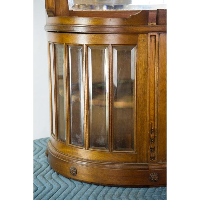 Put your favorite china and collectibles on display with this French oak breakfront display cabinet. This was originally...