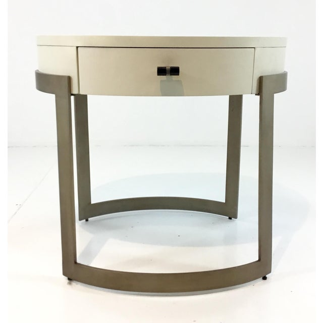 Stylish modern Caracole ivory and antique brass side table/nightstand, one drawer with a black pull, showroom floor sample