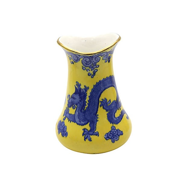 """Antique English yellow vanity set with dragon pattern. Maker's mark on underside. Dimensions: toothbrush holder, 4""""Dia x..."""