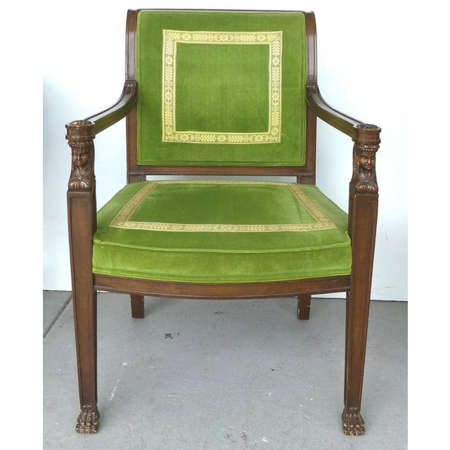 A pair of formal carved Renaissance style armchairs upholstered in velvet with tapestry ribbon trim. Original labels...