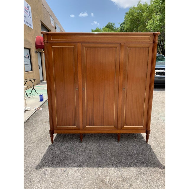 Beautiful French antique Louis XVI style armoires or wardrobes. made of mahogany, the mahogany wood has been finished with...