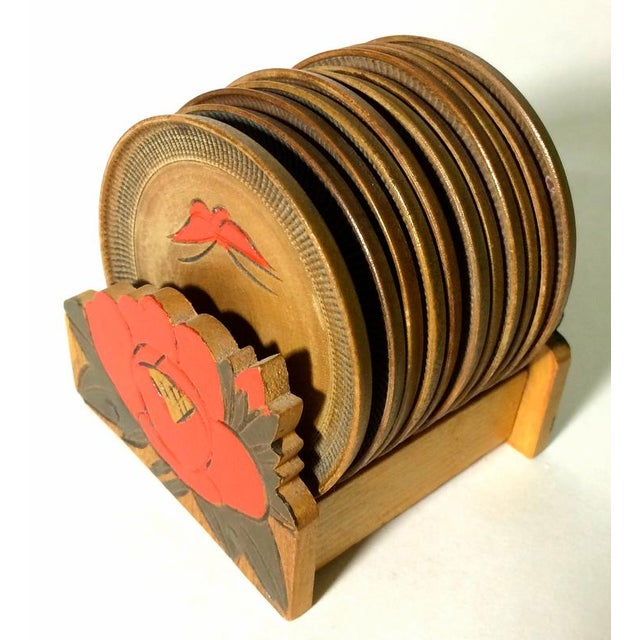 Circa 1940s carved and painted wooden coaster set and holder. Orange and yellow butterflies on each of the 11 coasters....