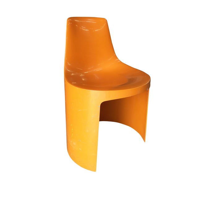 Set of 4 early 1960s Swedish designed orange plastic stacking Side Chairs by Overman. The Overman Company began production...
