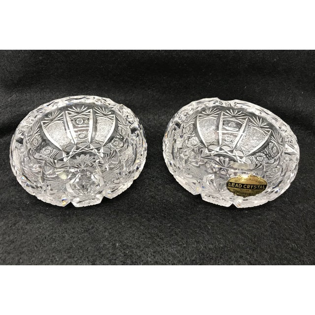 A set of two cut crystal ashtrays made in Czechoslovakia. Original sticker still attached.