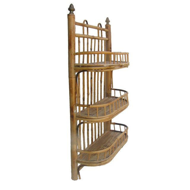 Charming bent and scorched bamboo / rattan wall hung storage piece with 3 woven reed shelves and brass finials. Ready to...