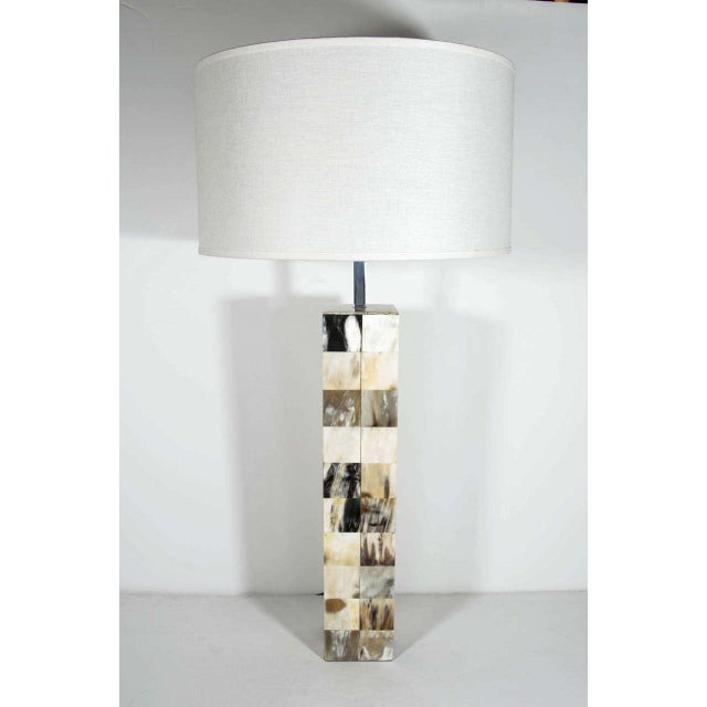 Mid-century modern lamp in genuine bone. Column design comprised of inlaid horn squares in hues of ivory, grey, black,...