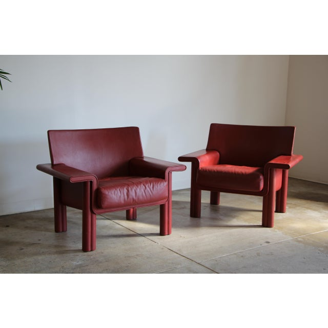 Pair of large leather lounge chairs by Afra and Tobia Scarpa for Meritalia. Unusual and sumptuous form. Stunning raspberry...