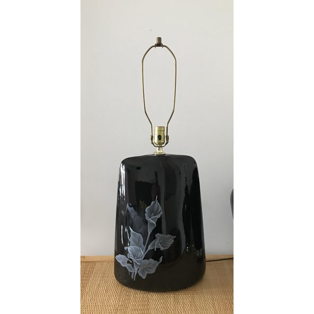 Tall Mid Century black ceramic table lamp with hand painted white Cala Lilies. Excellent condition. Works great.