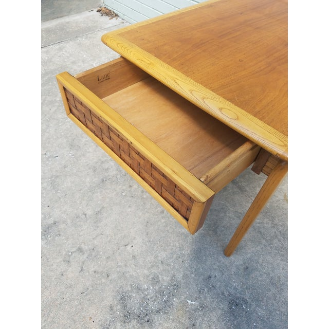 This listing consist of a mid century modern side table by lane perception with a basket weave rattan style drawer and...
