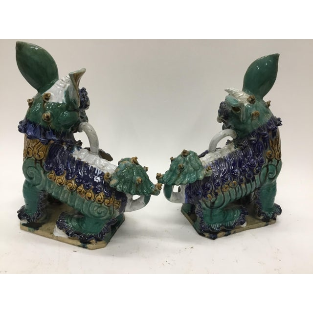 Early 20th Century Vintage Vietnamese Ceramic Foo Dog Figurines- A Pair For Sale - Image 4 of 13
