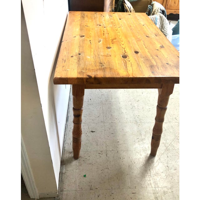 Vintage 1900's small pine table. The size is perfect for a small space or could be used as a Kitchen Island. The table...