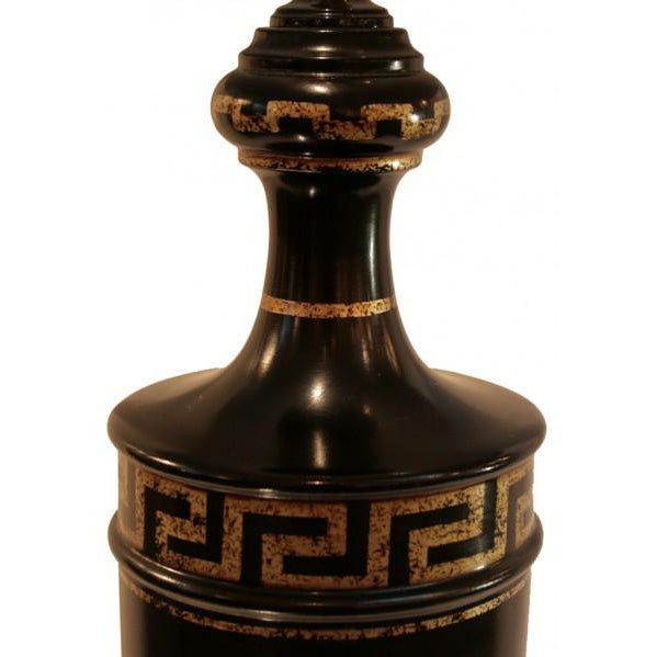 Circa 1940, lovely French Neoclassical wooden lamp, laquered in black with gold leafed greek key detail.