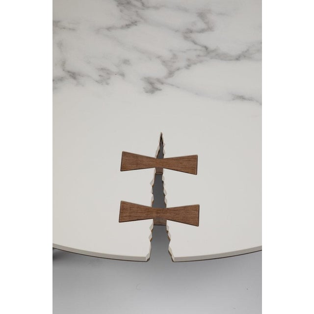 Hewed from 1/4 blackened steel with porcelain top and solid wood details, the Stone Forest Circle Coffee Table is a...