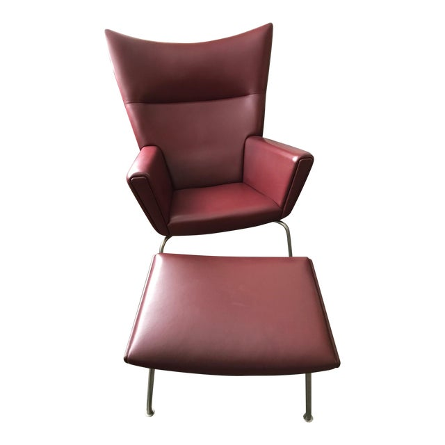 Hans J. Wegner for Carl Hansen & Søn Burgundy Wingback Chair and Ottoman For Sale