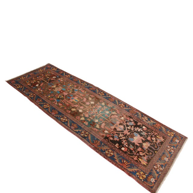 Hand knotted in Pakistan originating in the 1950s, this vintage Bidjar wool rug celebrates an intricate, uncommon marriage...