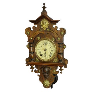 Antique Wooden Carved Wall Clock With Brass Applications For Sale