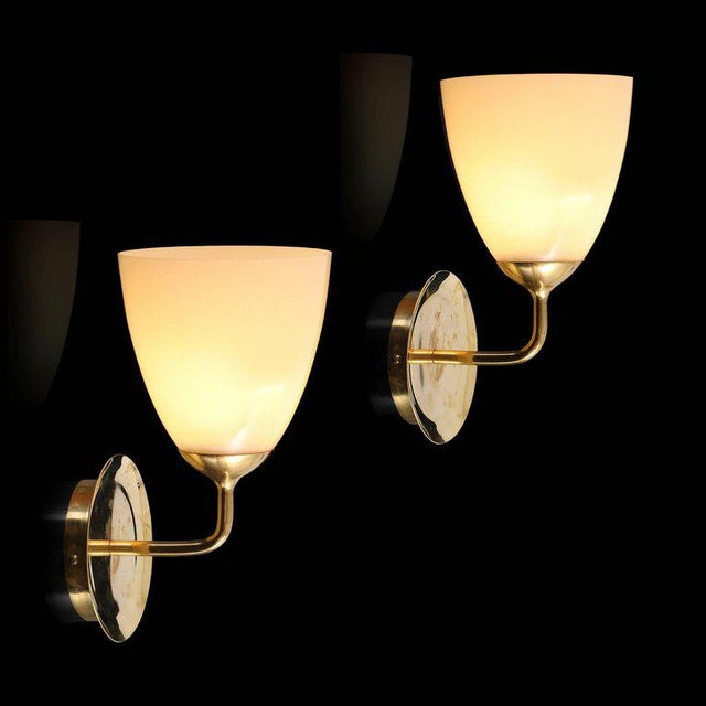 Large 1950s Paavo Tynell glass and brass sconces for Taito Oy. These are a unique pair of vintage custom made sconces that...