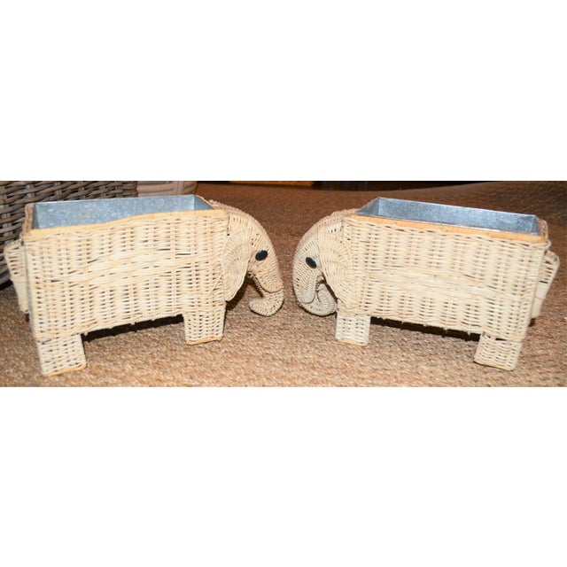 This this a very cute set of wicker elephant planters. They have a tin insert inside the interior for a planter. They have...