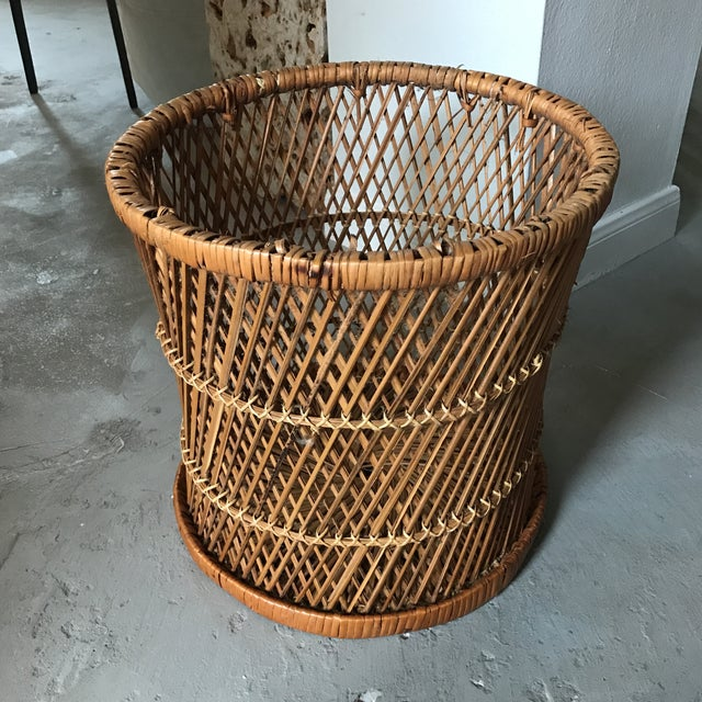 Offered is a vintage rattan woven drum foot stool. Flip it over it could also be used as a planter or wastebasket. Very...