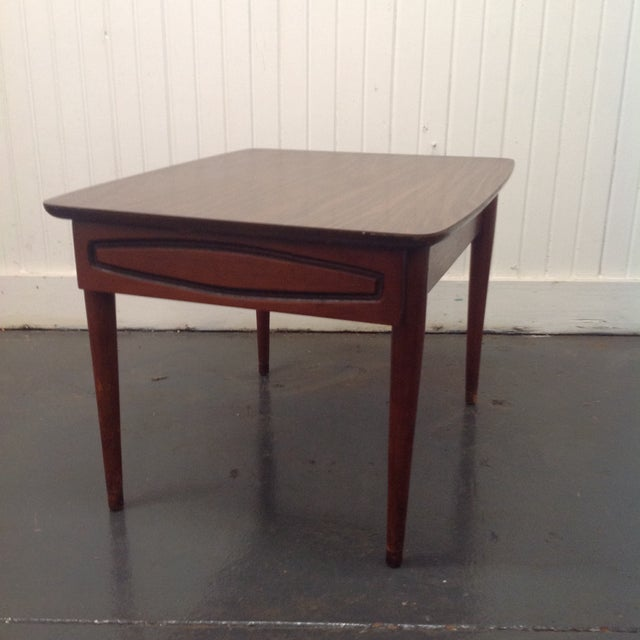 Offered is this sleek vintage Mid-Century Modern side table by Kroehler. Has its maker's mark.