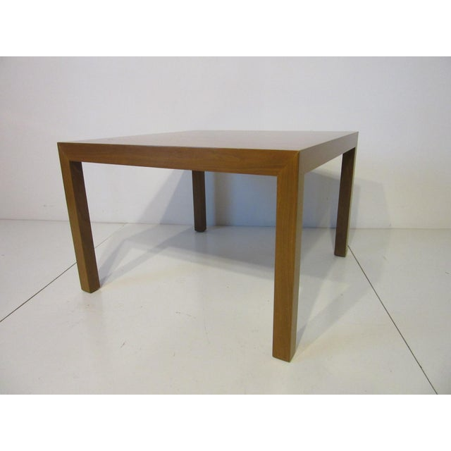 A nicely grained walnut side / lamp table in the Parson style retaining all metal manufacturing tags and labels by the...